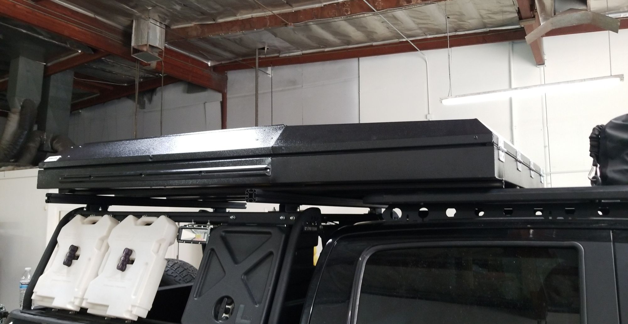 Alu-Cab tent mounted on rack
